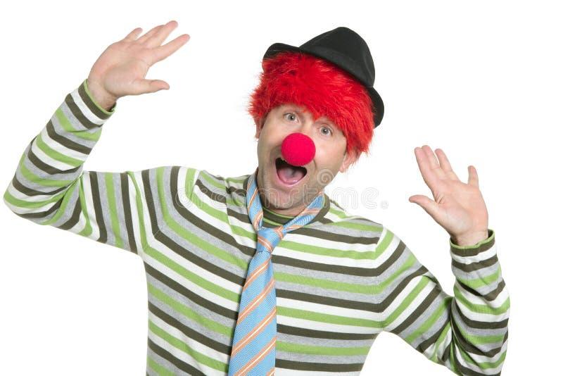Gesto engraçado feliz da peruca do redhead do palhaço imagens de stock royalty free
