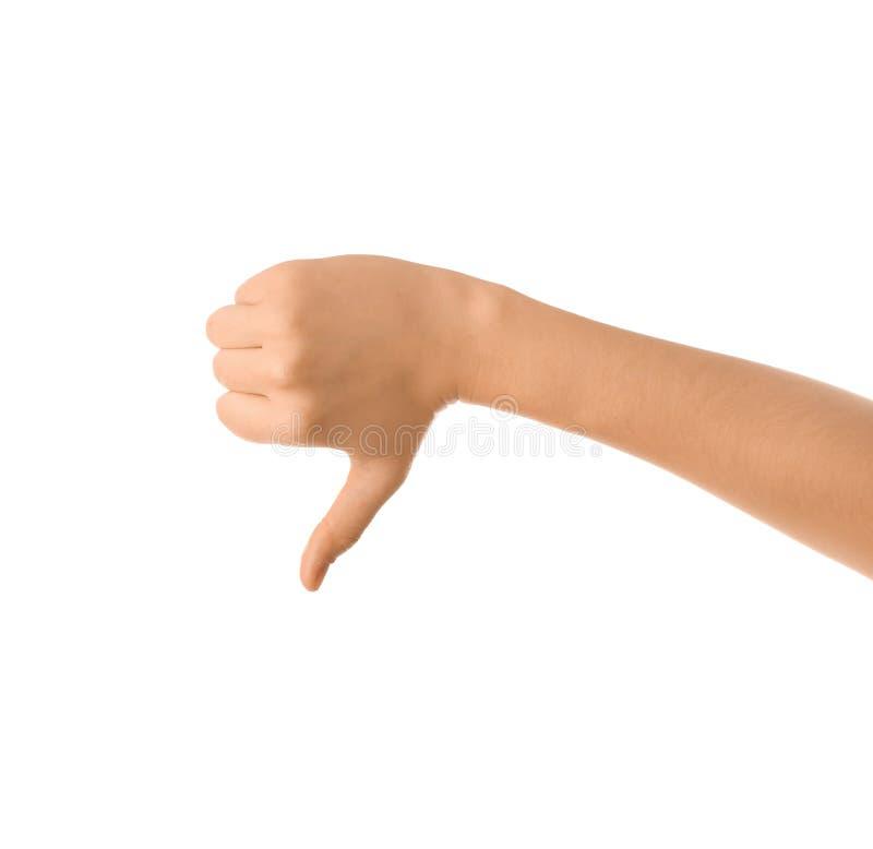 Gesto femminile del pollice-giù di rappresentazione della mano su fondo bianco fotografia stock libera da diritti