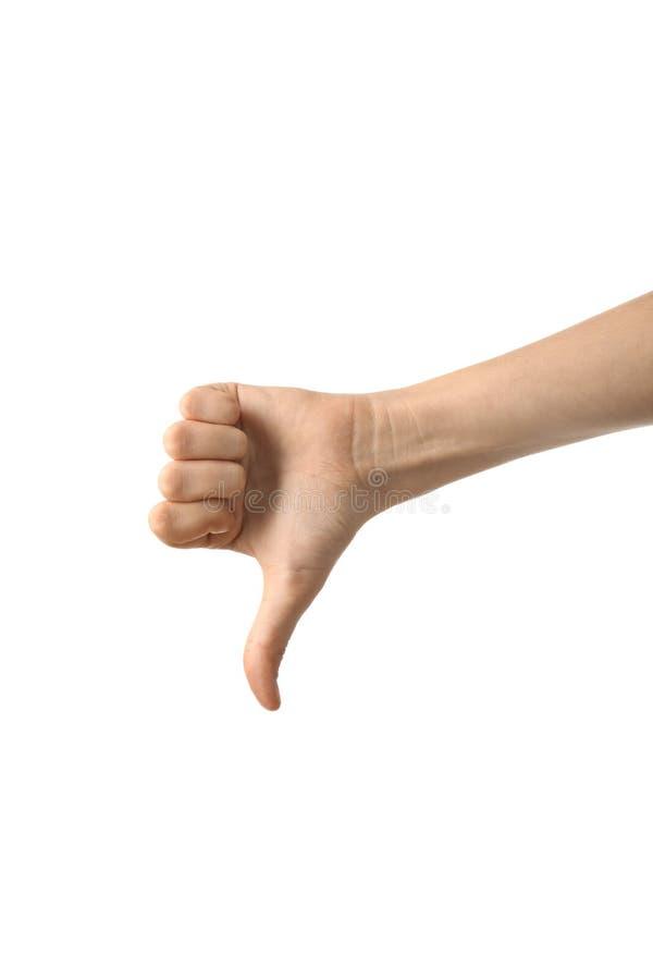 Gesto femminile del pollice-giù di rappresentazione della mano su fondo bianco immagine stock