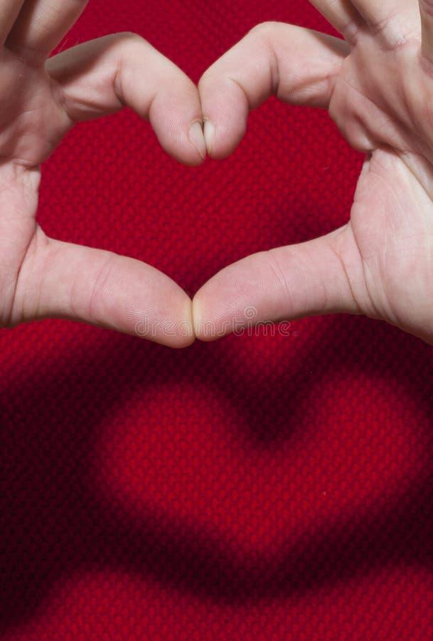 Gesto a forma di del cuore fotografie stock libere da diritti