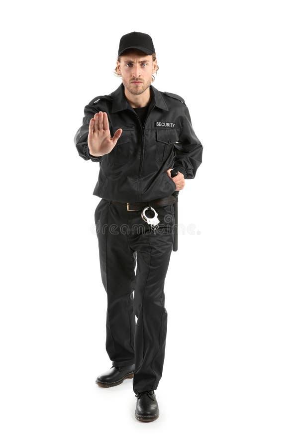Gesto masculino de la parada de la demostraci?n del guardia de seguridad en el fondo blanco fotografía de archivo