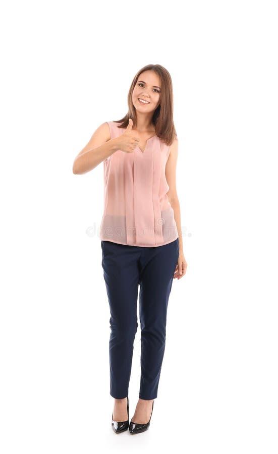 Gesto novo do polegar-acima da exibição da mulher de negócios no fundo branco fotografia de stock royalty free