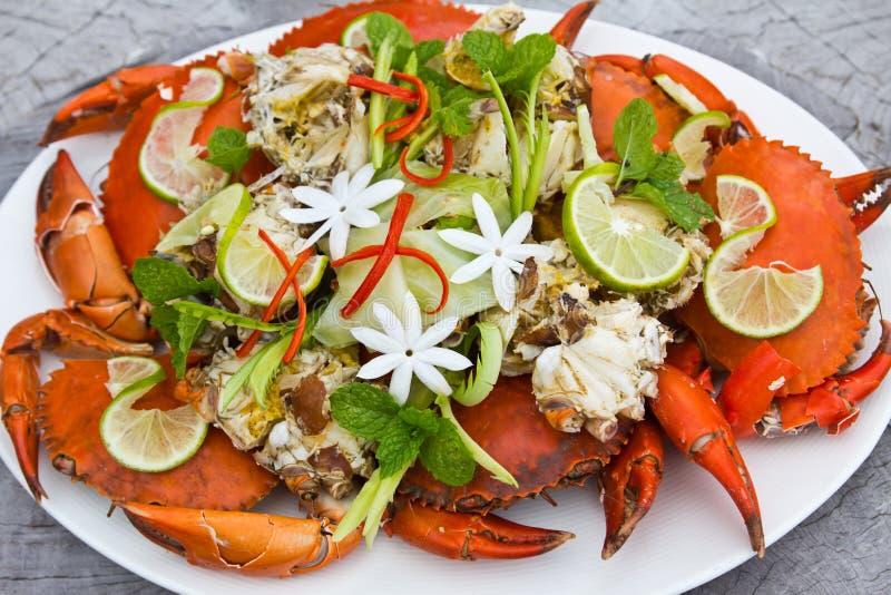 Gestoomde overzeese krabben stock afbeeldingen