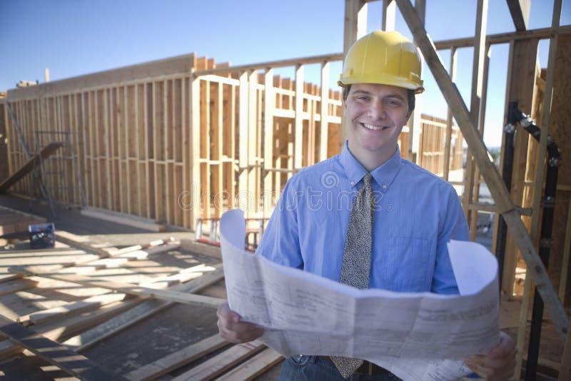 Gestor de local With Building Plans fotografia de stock royalty free
