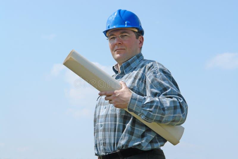 Gestore del cantiere con i programmi della costruzione fotografia stock libera da diritti