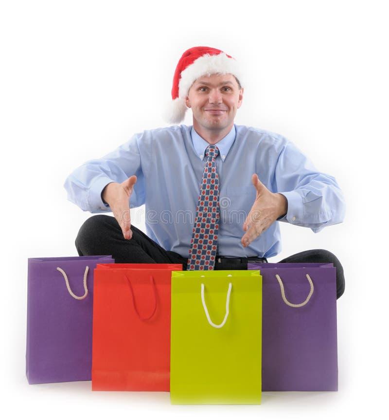 Gestore di vendite con i sacchetti di acquisto fotografia stock