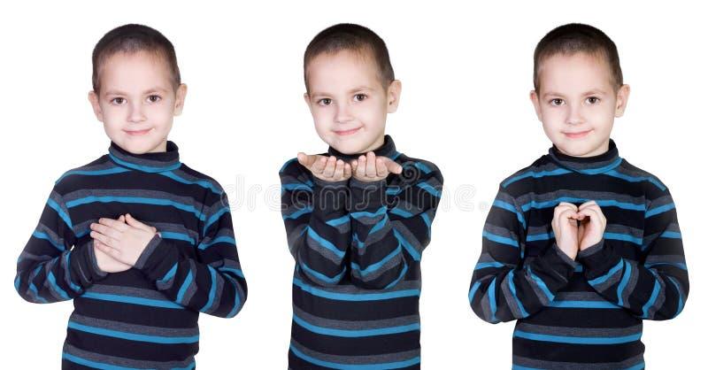 Gestos de mão do menino imagem de stock