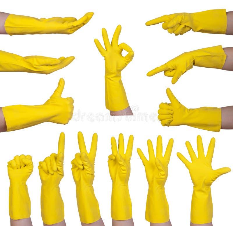 Gestos de mano en guante de goma amarillo foto de archivo