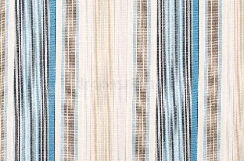 Gestreept blauw en bruin textielpatroon als achtergrond stock afbeelding