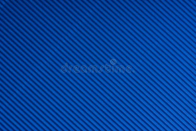 Gestreept blauw in reliëf gemaakt document Gekleurd Document Woedende textuurachtergrond stock afbeeldingen