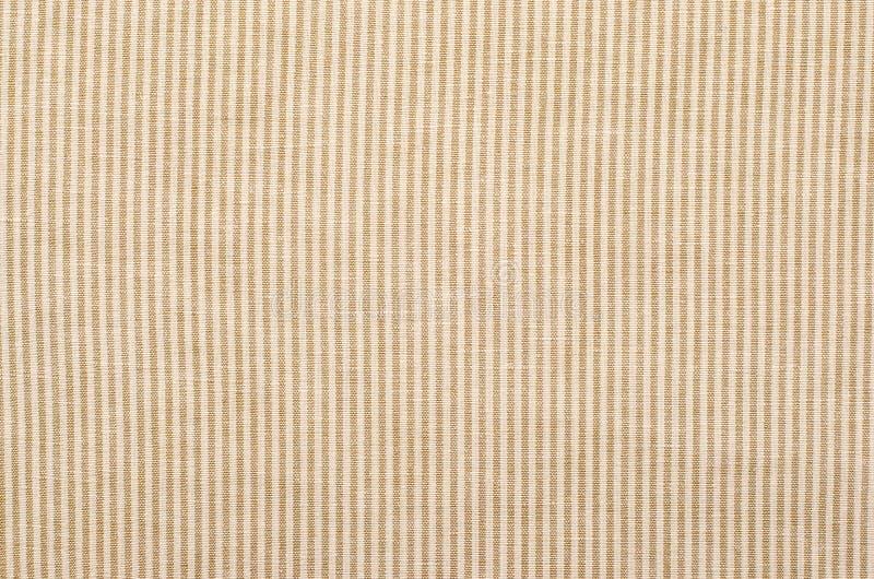 Gestreept bruin en beige textielpatroon als achtergrond stock foto's