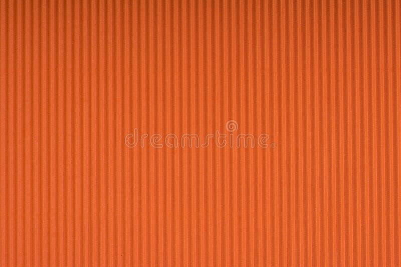 Gestreept in reliëf gemaakt oranje document Gekleurde document textuurachtergrond royalty-vrije stock foto