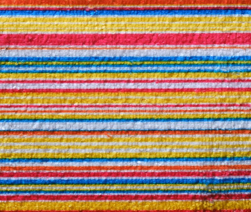 Gestreepte strandhanddoek nuttig als achtergrondpatroon stock foto