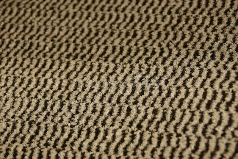 Gestreifte Gewebebeschaffenheit von einem Stück woolen Teppich lizenzfreies stockbild