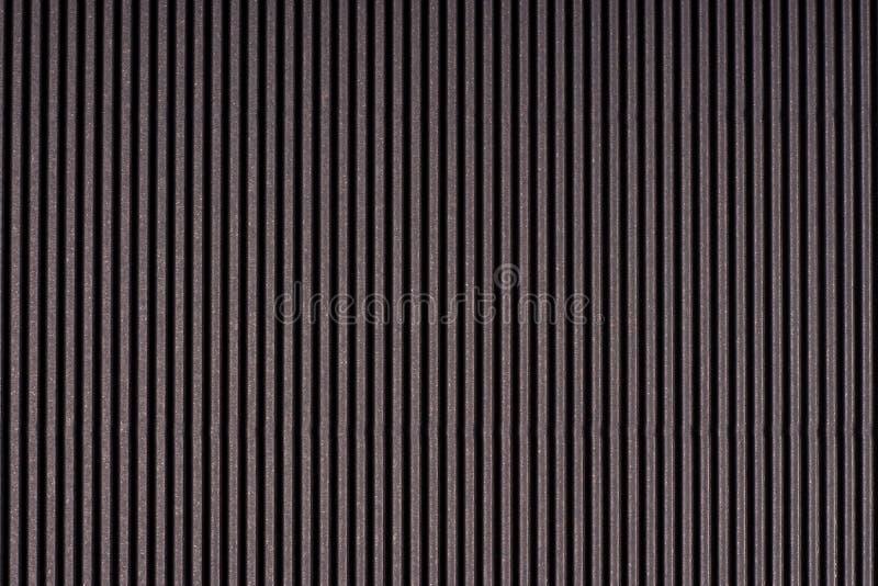 Gestreiftes dunkelgraues prägeartiges Papier Farbiges Papier Schwarzer Beschaffenheitshintergrund lizenzfreie stockfotografie