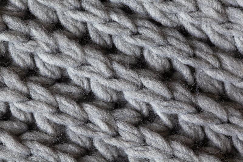 Gestrickte woolen strukturierte Oberfläche, Makro Weicher grauer Merinowollemusterhintergrund, Nahaufnahme Flache Lage des Herbst stockfotografie