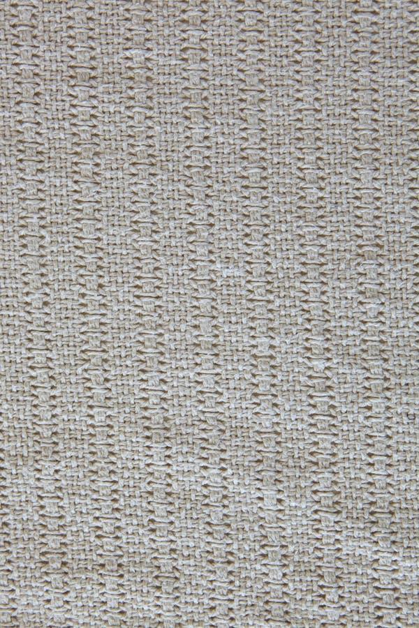 Gestrickter Beige Baumwollnullhintergrund Stockbild