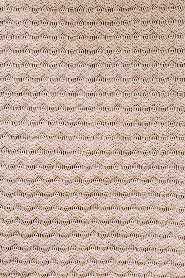 Gestrickter Hintergrund strickendes Muster der Wolle stricken Beschaffenheit des gestrickten woolen Gewebes für Tapete und einen  lizenzfreie stockfotografie
