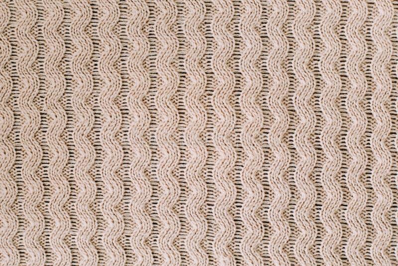 Gestrickter Hintergrund strickendes Muster der Wolle stricken Beschaffenheit des gestrickten woolen Gewebes für Tapete und einen  lizenzfreie stockfotos