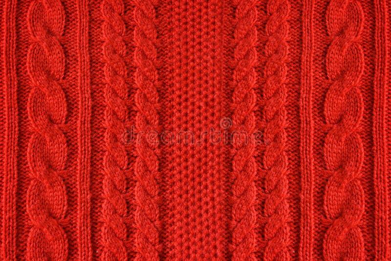 Gestrickter woolen Hintergrund, rote Beschaffenheit lizenzfreie stockbilder