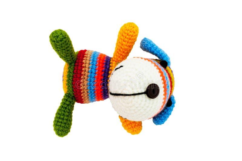 Gestricktes Spielzeug - gestreifter Lügenhund stockbild
