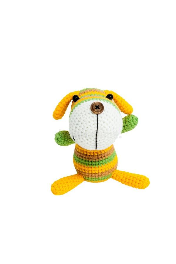 Gestricktes Spielzeug - gestreifter sitzender Hund lizenzfreie stockfotografie