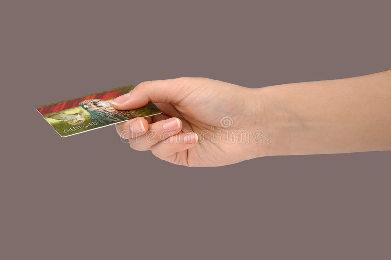 Gesture 11 (credit card). Female hand holding a general credit card royalty free stock photography