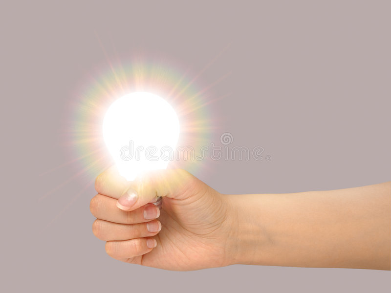 Gesture 12 (light bulb). Female hand holding a shining light bulb stock images