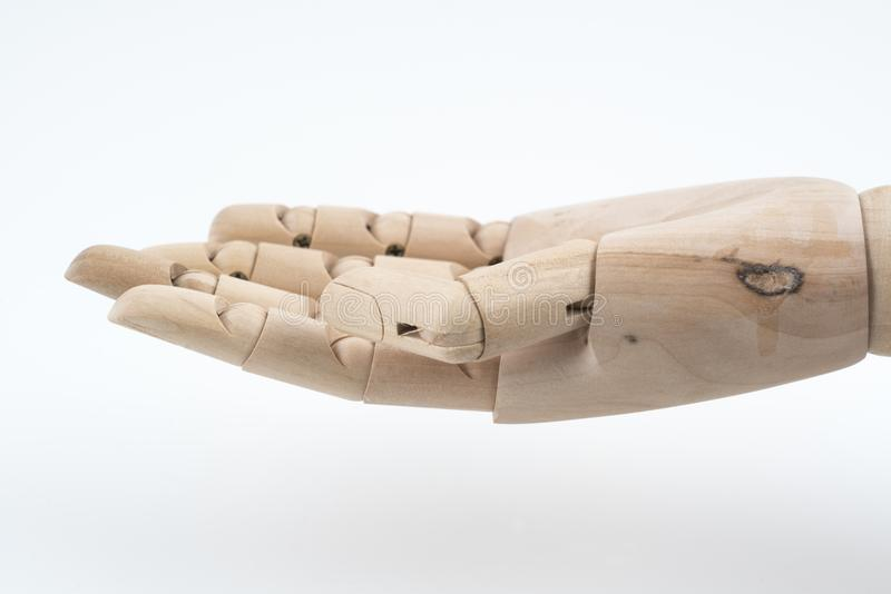 the gesture of a jointed wooden hand open upwards. stock image