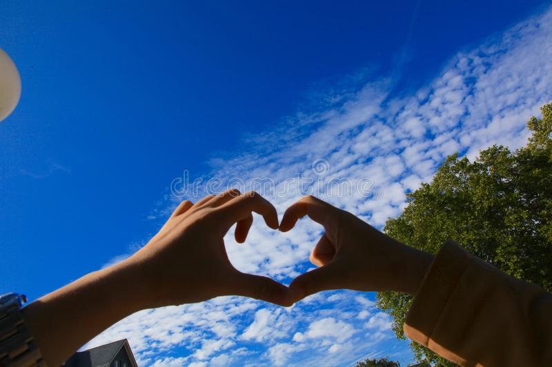 Love. This gesture of love shows our affection to German sunny weather stock photos