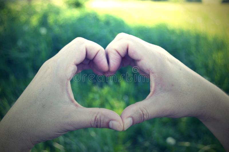 Gesture of love. Simple heart. stock photo