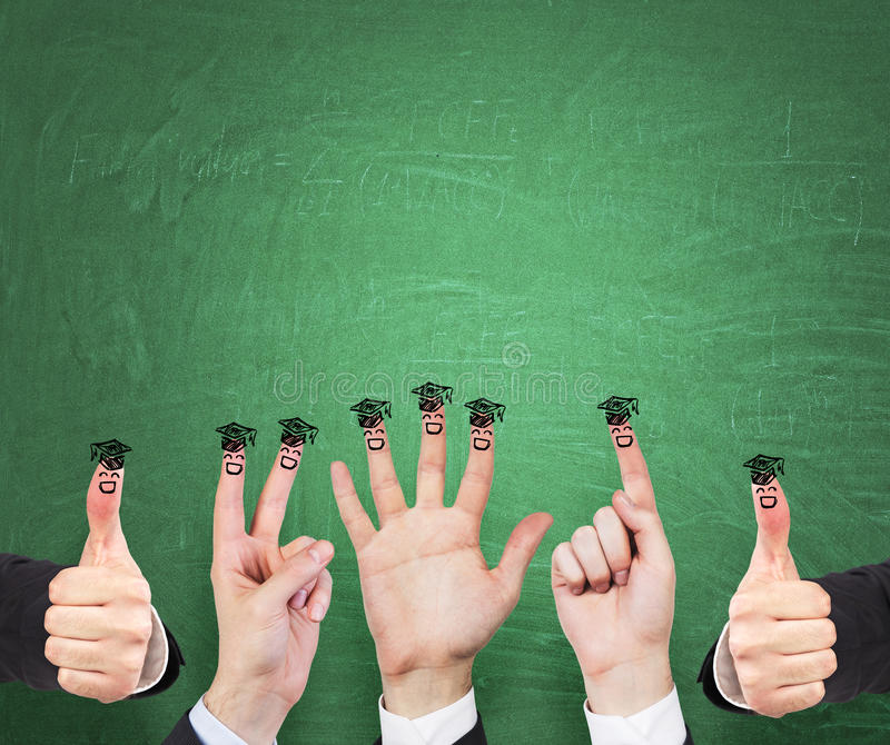 Gestures, fingers and sketched graduation hats. Green chalkboard as a background stock photo