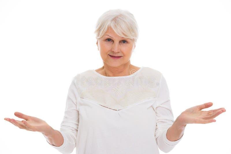Gesturing senior della donna immagine stock libera da diritti