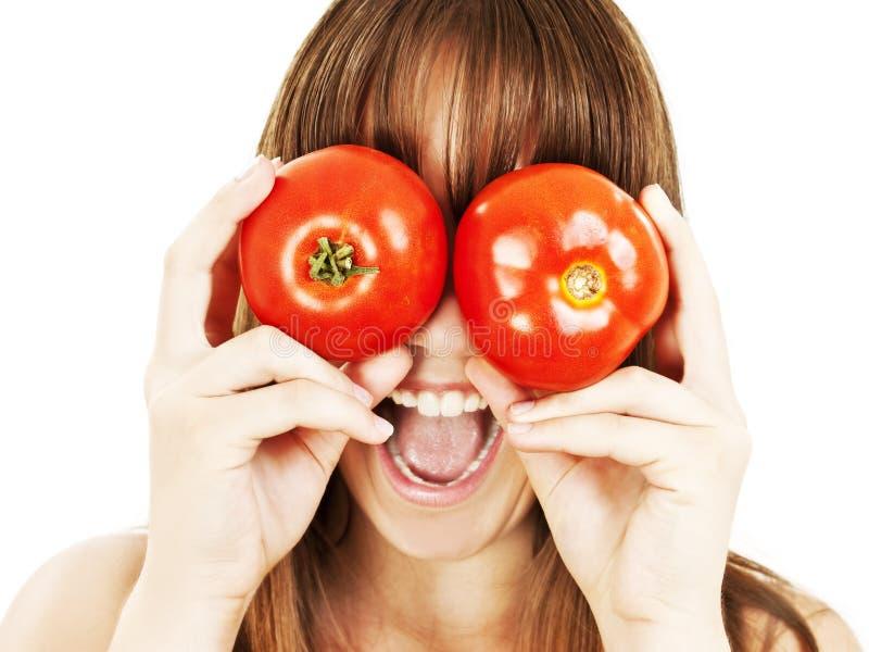 Gesunde Leute: Tomatefrauenspaß lizenzfreie stockfotos