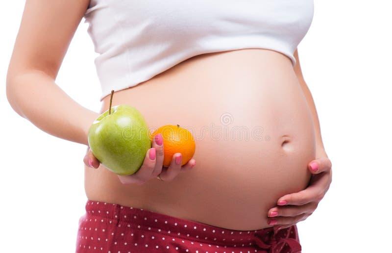 Gesunde Nahrung und Schwangerschaft Bauch der schwangeren Frau lizenzfreies stockbild