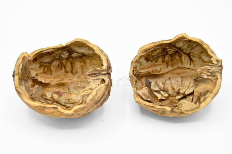 Gesunde und nahrhafte beige braune Walnussk?rner Zerquetschte Walnussschalen lizenzfreie stockbilder