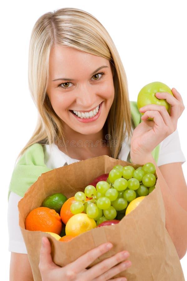 Gesunder Lebensstil - freundliche Frau mit Frucht stockbilder