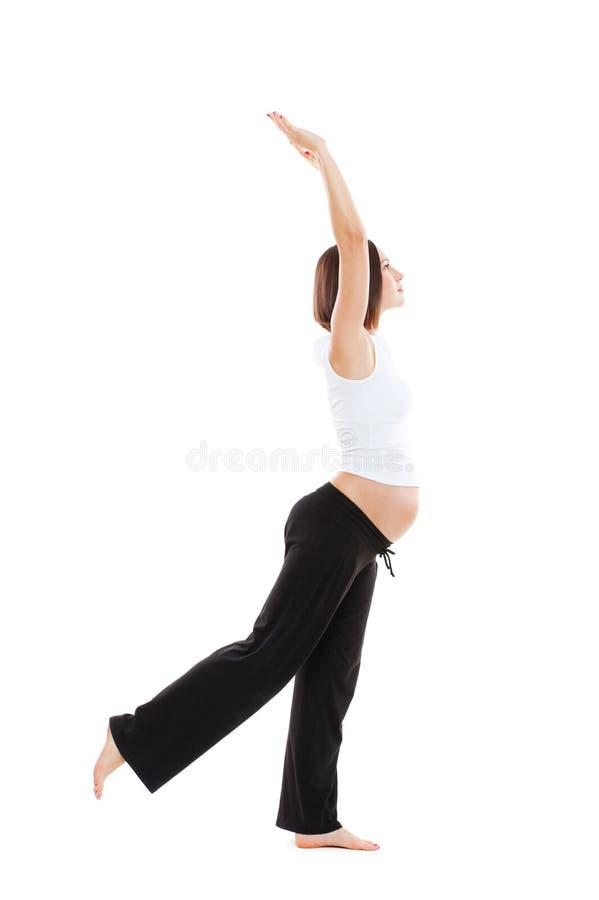 Gesundes Handeln der schwangeren Frau gymnastisch stockfotografie