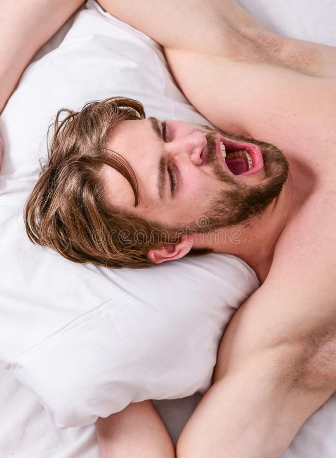 Get adequate and consistent amount of sleep every night. Expert tips on sleeping better. How much sleep you actually. Need. Bearded man sleeping face relaxing stock photos