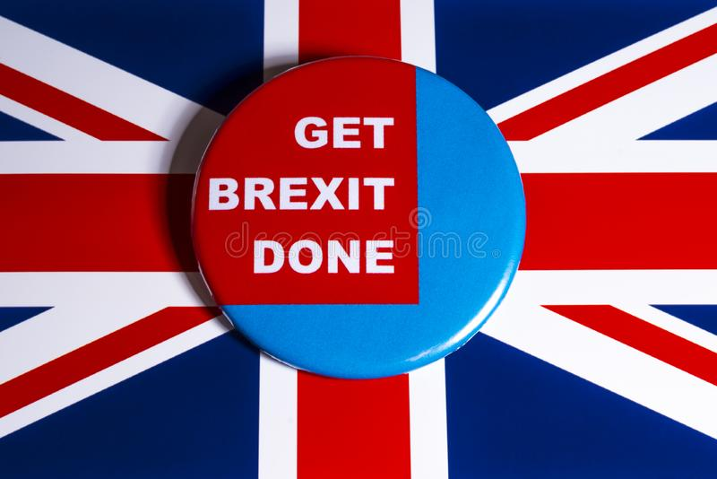 Get Brexit Done. London, UK - November 21st 2019: Get Brexit Done badge, pictured over the United Kingdom flag stock photos