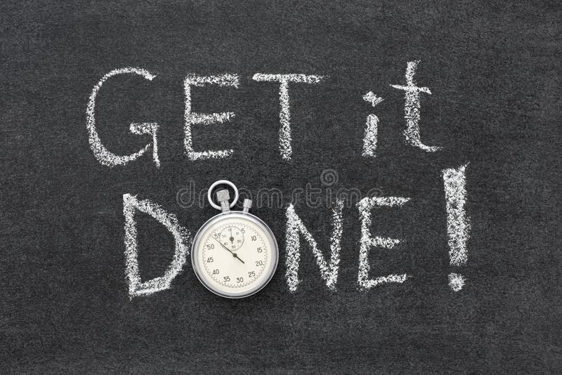 Get it done. Response time phrase handwritten on chalkboard with vintage precise stopwatch used instead of O stock images