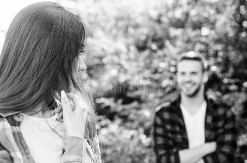 Get her attention. Man hipster falling in love pretty girl. Casual meeting. Love from first sight. If woman knows you royalty free stock images