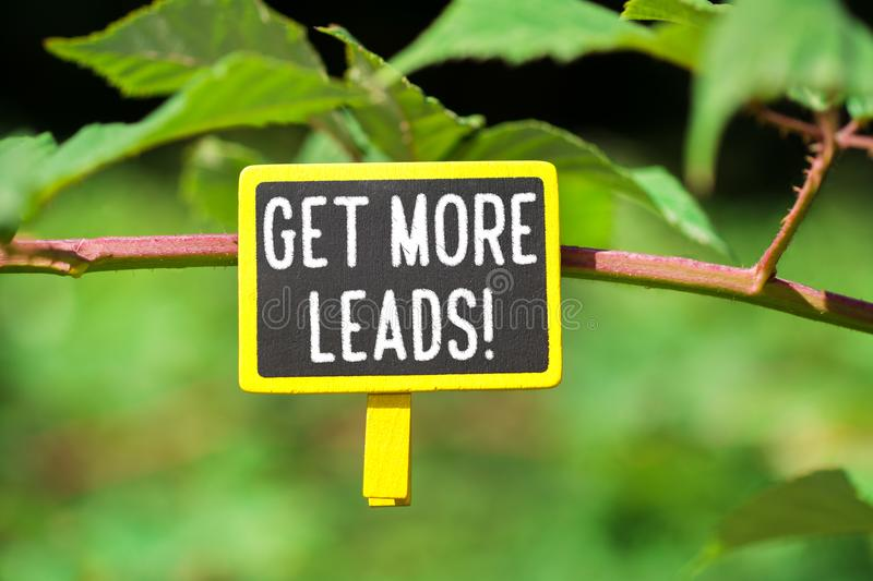 Get more leads text on board stock photos