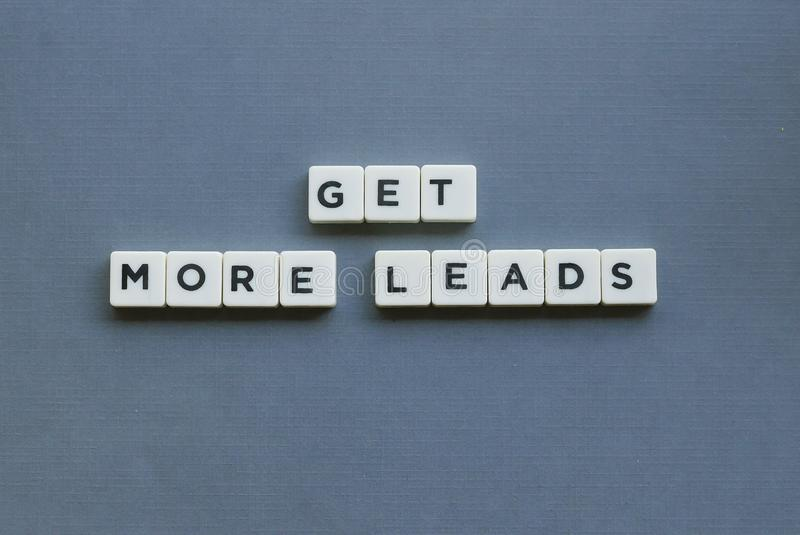 ' Get More Leads ' word made of square letter word on grey background stock photos