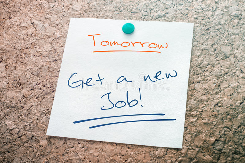 Get A New Job Reminder For Tomorrow On Paper Pinned On Cork Board. A Get A New Job Reminder For Tomorrow On Paper Pinned On Cork Board royalty free stock photo