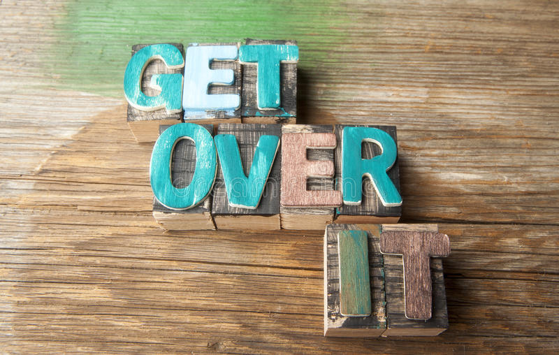 Get Over It - Wooden typeset word concept royalty free stock photos