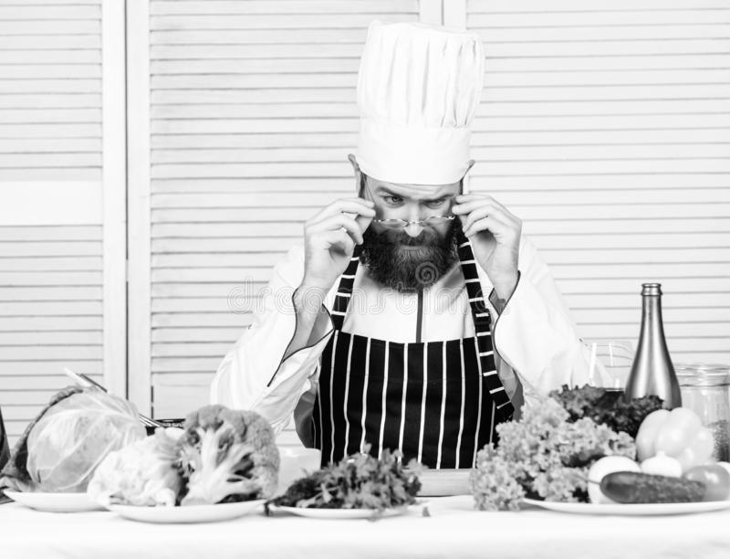 Get ready. Man bearded chef getting ready cooking delicious dish. Chef at work starting shift. Guy in professional. Uniform ready cook. Master chef concept stock photography