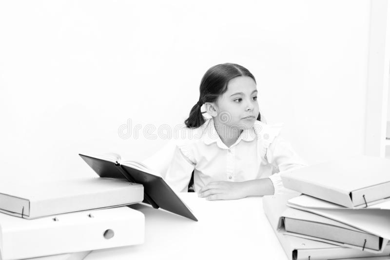 Get rid of boring task. Girl bored pupil sit at desk with folders and books. Issues of formal education. Back to school. Concept. Kid cute tired of studying stock photos