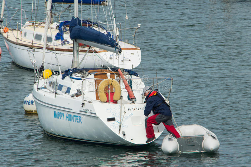 Get in sailing boat stock images