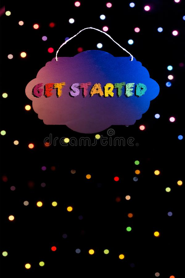 Get started wording written on blank sign board  in hand stock illustration